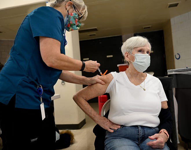Irene Thompson, 75, of Framingham receives the COVID-19 vaccine at Keefe Tech in Framingham, Feb. 6, 2021.