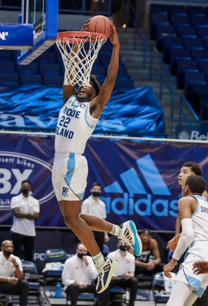 URI's Makhel Mitchell goes in for a dunk in the first half against UMass on Saturday night at the Ryan Center. Feb. 6, 2021