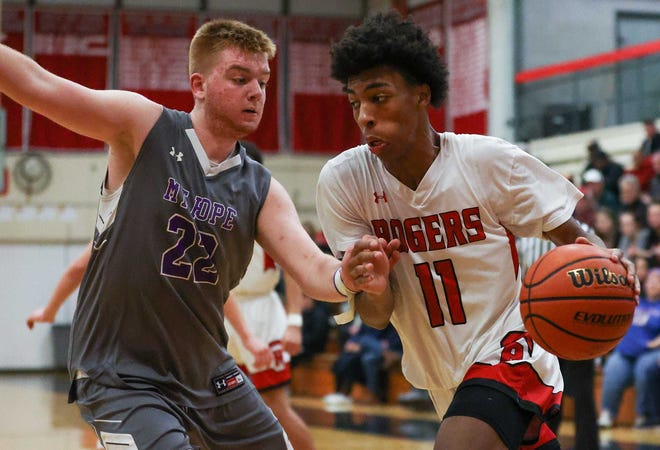 Roshawn Fleming and the Rogers boys basketball team hosts rival Middletown Saturday afternoon.