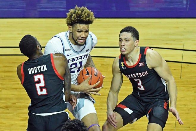 Kansas State center Davion Bradford (21) battles against Texas Tech defenders Jamarius Burton (2) and Clarence Nodolny during  Saturday's game at Bramlage Coliseum.