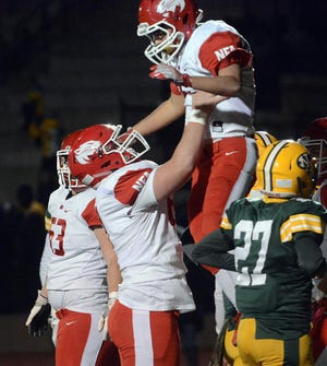 Norwich Free Academy's Joe Klick lifts up Sean Preston after Preston's touchdown run against New London in 2018. Klick recently signed a national letter of intent to attend and play football at Pace University.