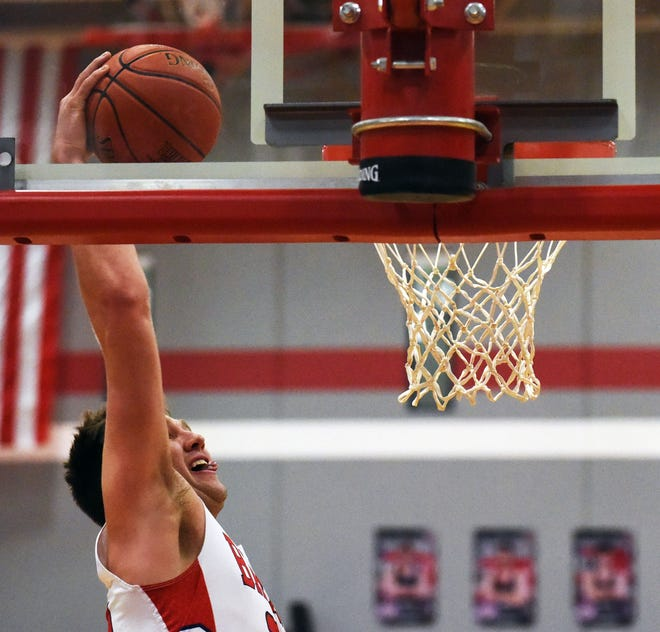 Ballard's Connor Drew goes up to throw down a one-handed dunk during the No. 1 (3A) Bombers' 84-38 victory over Gilbert Feb. 2 at Huxley.