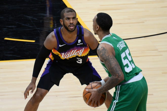 The Suns' Chris Paul (3) guards the Celtics' Jeff Teague during Sunday's second half.