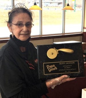 """Beth """"Buffi"""" Jackson holds a plaque commemorating her 50th work anniversary at the Worcester Papa Gino's located in Lincoln Plaza."""