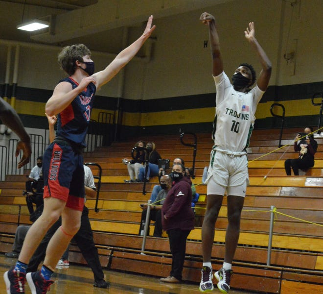 Pine Forest's Isaiah Washington scored 37 points Friday in the Trojans' win against Gray's Creek.