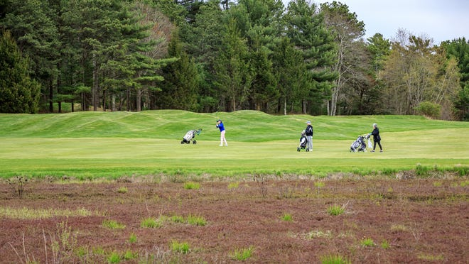 Golfers enjoy a spring day at Southers Marsh Golf Club in Plymouth. Despite the snow over the weekend, golfers are already dreaming of warmer days ahead.