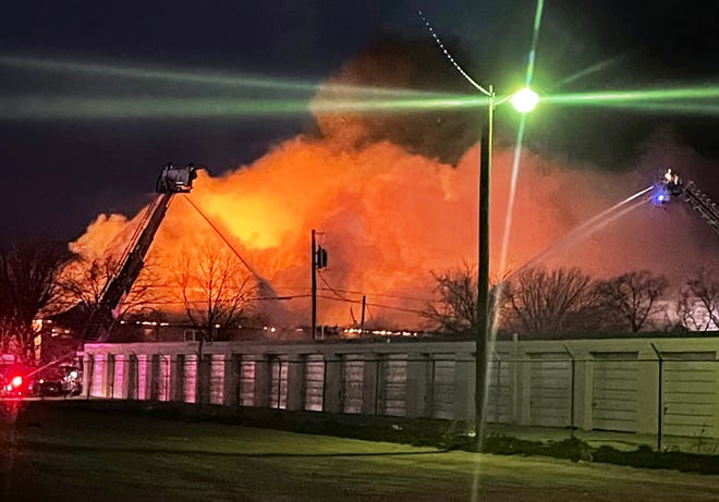 Chelsey Phath, who with her husband, Jimmy, operate Chimmy's Donuts just off North First Street, took this photo of the fire at Briarwood Apartments close to 7 a.m. Sunday. They were working when emergency vehicles roared by. Looking east, they saw flames and smoke about three blocks away.