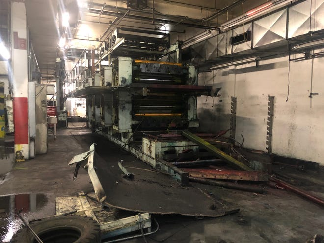 The printing press machinery in the basement of the Sun's home at 545 Fifth Street this week, during a break in the removal process. The Harris 1650 press was installed in 1978 and will now be removed. It hasn't been used since 2015 when publication of the Sun's print edition moved to a larger facility.