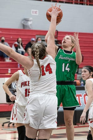 Huntington's Allison Basye shoots over Piketon to score one of her 46 total points for the game. Basye broke her single score record for Huntington and tied the three-point shot record previously achieved by Ariel Sams in 2015. Huntington defeated Piketon 56-34.