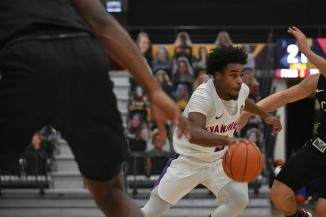 Shamar Givance drives to the basket during Evansville's game Sunday against Loyola.