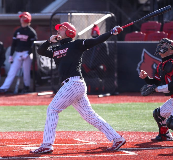 Louisville's Cameron Masterman bats during a team scrimmage on Friday, February 5, 2021.