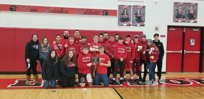 The Plymouth High School wrestling team poses for a photo after tying with Crestview for first place at the Firelands Conference Championships on Saturday at New London High School.