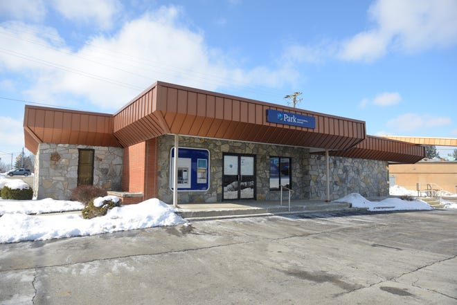 Nearly $2,000 was stolen from Park National Bank's West Cook branch Friday.