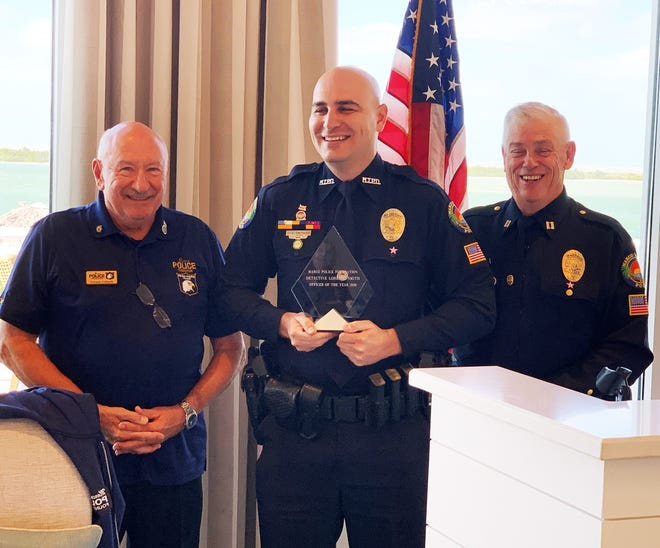 Marco Island Police Department Det. Lorenzo Smith (center) receives his Officer of the Year Award from Police Foundation President Vernon Geberth (left) and Captain Richard Stoltenborg.