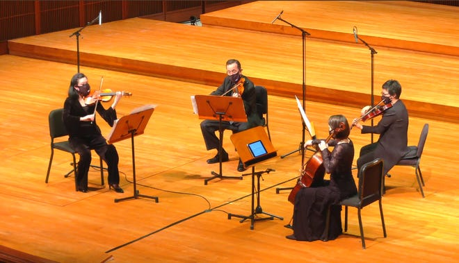 Violinist Jeanyi Kim and Michael Giacobassi, violist Erin Pipal and cellist Madeleine Kabat perform during the Milwaukee Symphony's season-opening concert.