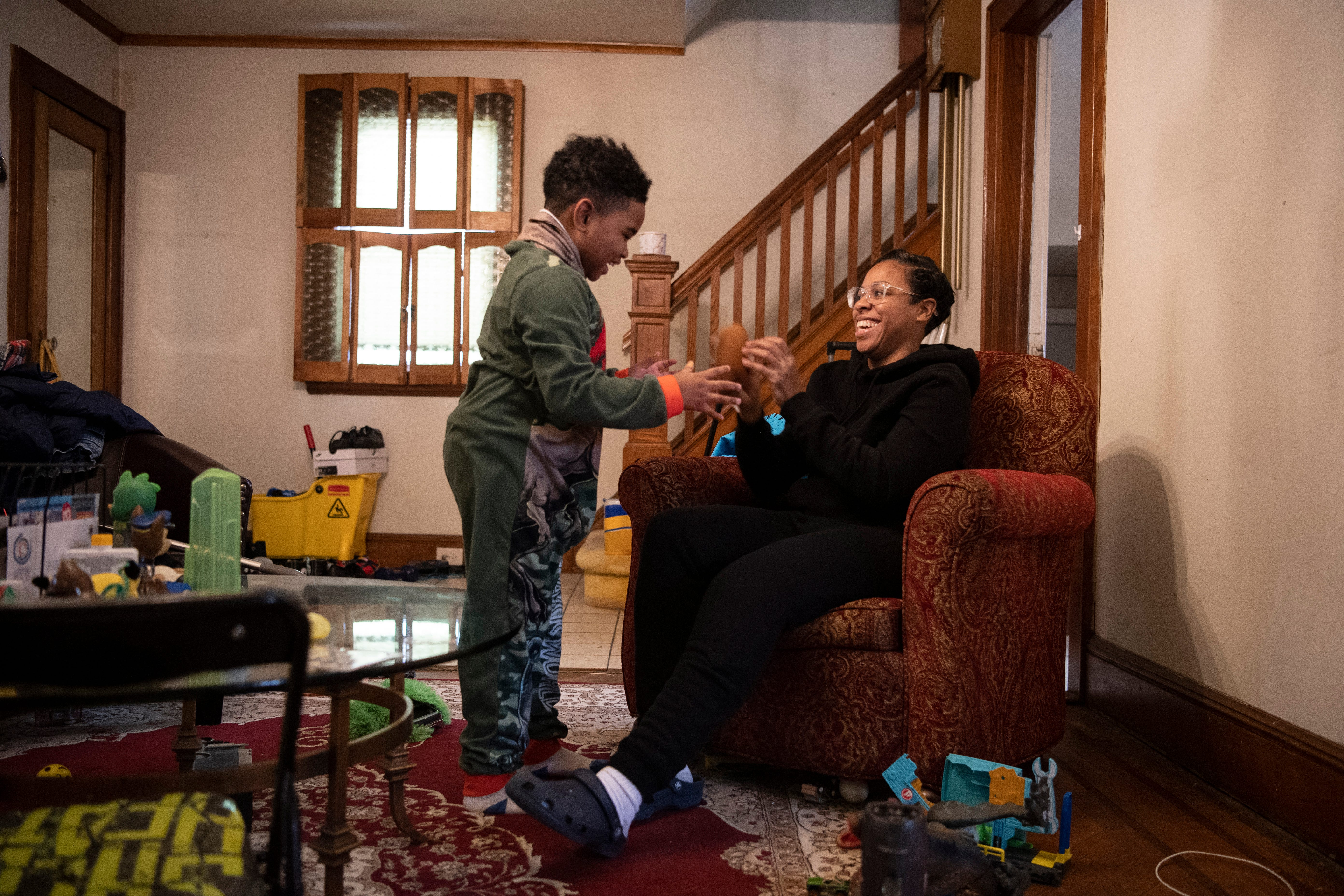 Shakima Thomas, of Newark, became an activist for clean water after learning her son had lead in his blood. Thomas plays with her son Bryce, 6, in their home in Newark on Saturday, February 6, 2021