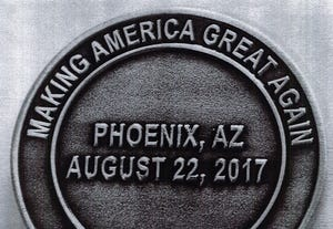 A photo of the coin, as put into evidence in a class-action lawsuit against Phoenix police Chief Jeri Williams and the city of Phoenix.