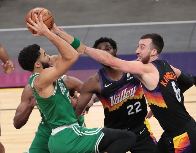 Phoenix Suns forward Frank Kaminsky (8) fouls Boston Celtics forward Jayson Tatum (0) during the first quarter at Phoenix Suns Arena Feb. 7, 2021.