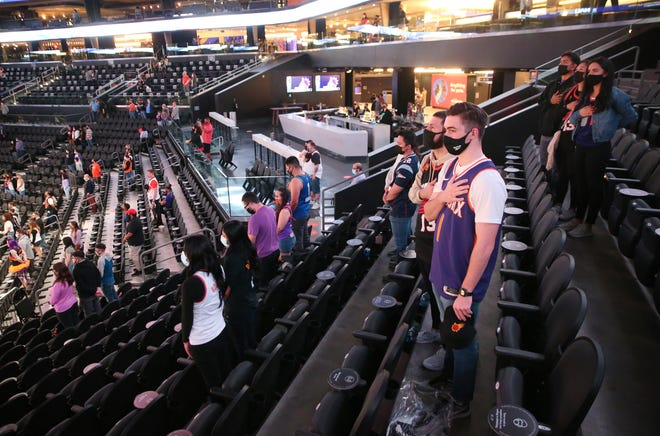 Fans stand for the national anthem before the Suns play against the Boston Celtics at Phoenix Suns Arena Feb. 7, 2021.