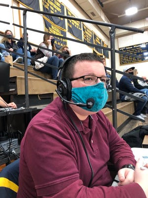 Jacob Hitz, a 2019 Elco grad, calls the action during a recent basketball livestream at the school.