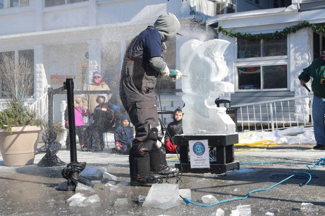 An ice sculptor from Elegant Ice Creations of Broadview Heights begins to carve out an eagle from what started as a 300-pound block of ice at Lakeside's Fire & Ice Fest on Saturday.