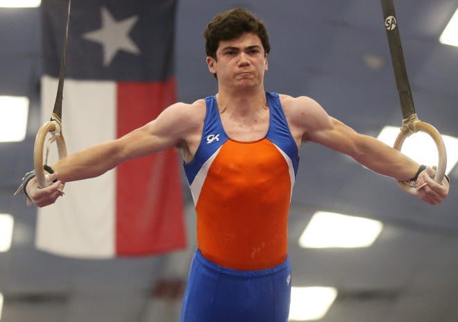 San Angelo Central High School's Robert Schut competes on still rings during an optional gymnastics meet against the Ector County ISD in San Angelo on Saturday, Feb.  6, 2021.