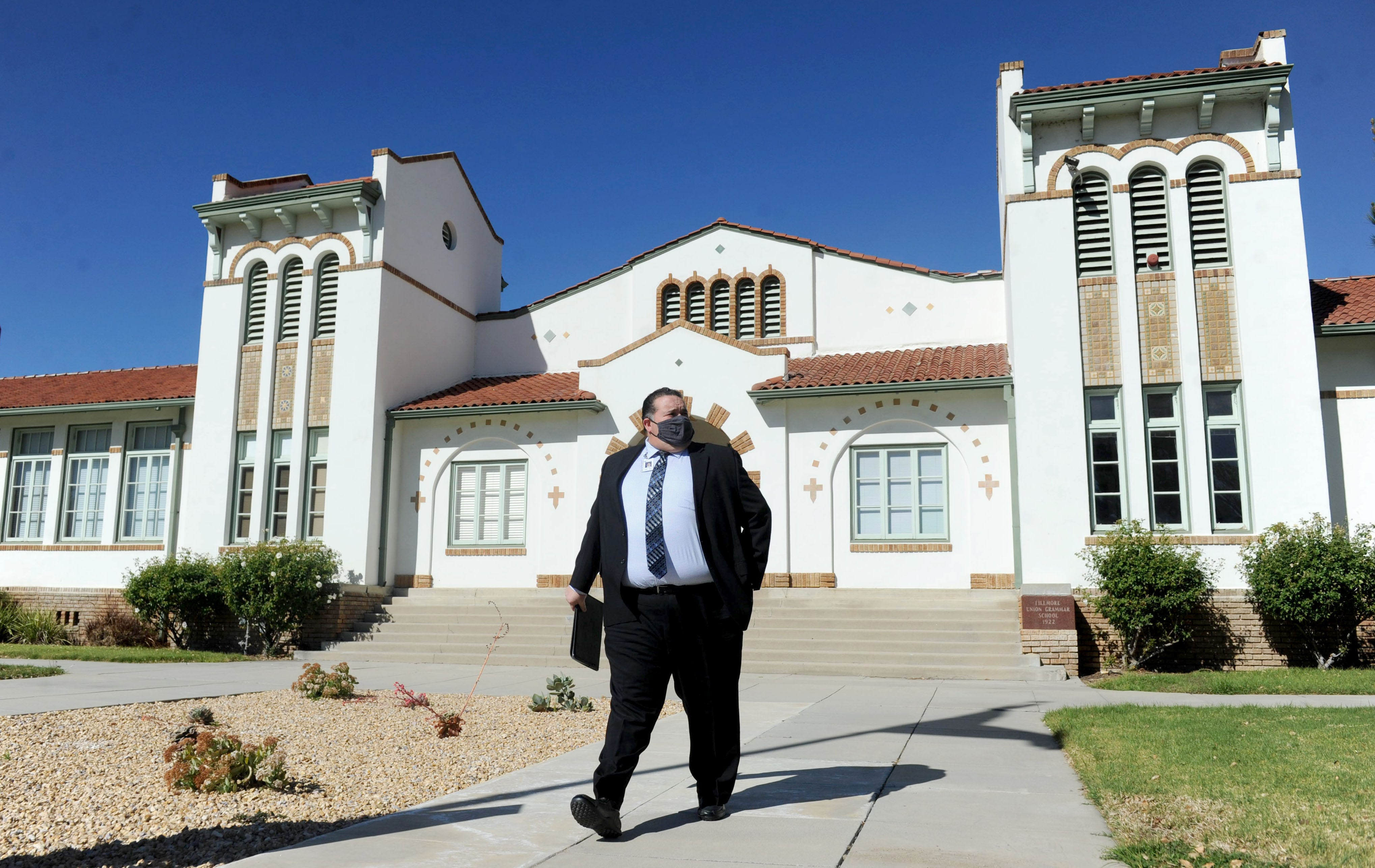 Fillmore Superintendent Adrian Palazuelos, who stepped down recently, walks out of his office on Friday, Feb. 5, 2021, at Fillmore Unified School District.