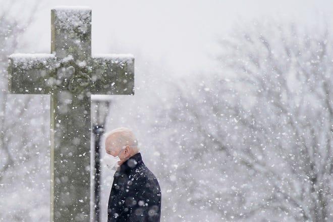 President Joe Biden departs after attending Mass at St. Joseph on the Brandywine Catholic Church as snow falls, Sunday, Feb. 7, 2021, in Greenville.