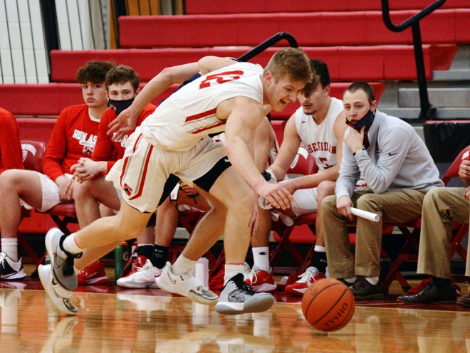 Nate Johnson chases after a loose ball during Sheridan's 64-51 win against Lancaster on Feb. 6 in Thornville. Johnson scored a team-high 20 points.