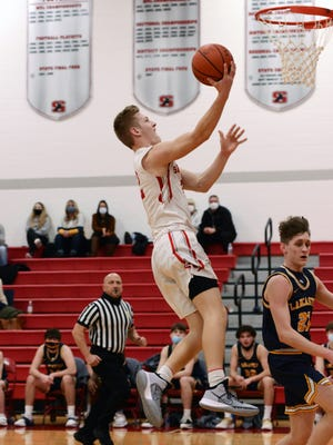 Nate Johnson goes up for fast break layup during Sheridan's 64-51 win against Lancaster on Feb. 6 in Thornville. Johnson scored a team-high 20 points.