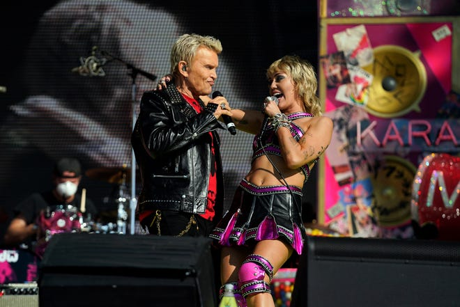 Miley Cyrus, right, and Billy Idol perform before the Kansas City Chiefs play the Tampa Bay Buccaneers in Super Bowl LV.