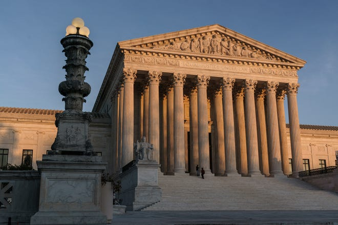 In this Friday, Nov. 6, 2020 file photo, The Supreme Court is seen at sundown in Washington.