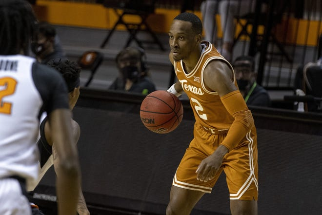 Texas guard Matt Coleman III dribbles the ball against Oklahoma State last Saturday in Stillwater, Okla. Coleman and teammate Courtney Ramey struggled in the 75-67 double-overtime loss.