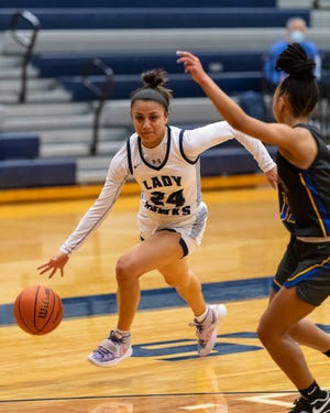 Hendrickson's Erika Suarez drives against Pflugerville's Jaida Gomez during the Hawks' 60-48 win last week. Suarez paced No. 7 Hendrickson with 26 points in the victory.