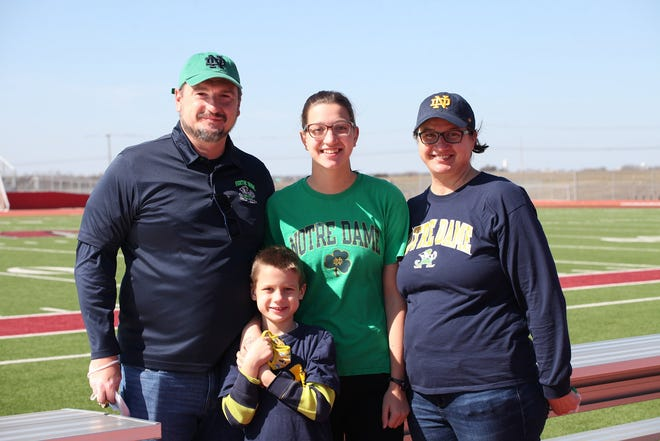 Boris and Tatjana Herceg join Weiss swimmer Ana Herceg, along with her younger brother, at an afternoon signing day ceremony Feb. 3 at Weiss. Herceg signed to swim with Notre Dame.