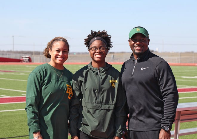 Letricia and Cleveland Francois join Weiss sprinter Michaela Francois at an afternoon signing day ceremony Feb. 3 at Weiss. Francois will run track at Baylor.