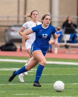 Kaitlynn Melton brings the ball upfield for Pflugerville in a nondistrict match against Cedar Park earlier this season. Melton had a hat trick in a 7-0 win over Cedar Creek last week.