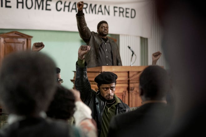 "This image released by Warner Bros. Pictures shows Lakeith Stanfield, foreground center, and Daniel Kaluuya, background center, in a scene from ""Judas and the Black Messiah."" (Warner Bros. Pictures via AP)"