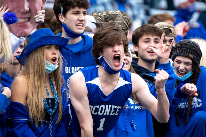 Oconee County fans cheer during the second half of the 2020 Class 3A GHSA State Championship football game between the Pierce County Bears and Oconee County Warriors at Center Parc Stadium in Atlanta, Ga. on Wednesday, Dec. 30, 2020. (Casey Sykes for The Athens Banner-Herald)