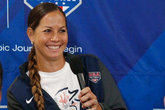 Cat Osterman smiles as she answers a question during a news conference to announce the USA Softball 2020 Women's Olympic Team in Oklahoma City in 2019. Osterman says she will retire from the sport this year. The left-handed pitcher will represent Team USA at the Olympics before defending the Athletes Unlimited title she won last season at age 37.