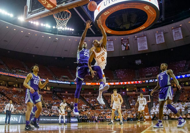 Texas guard Matt Coleman III is fouled as he drives to the basket by Kansas State forward Montavious Murphy in their game last season in Austin.