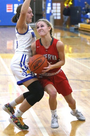 Minerva's Jenna Cassidy, right, shown in an earlier game, scored 23 points in the Lions' victory over Sandy Valley on Thursday night.