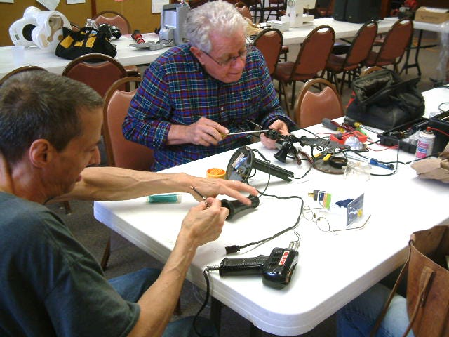 Volunteers work on fixing items at the most recent Repair Café in Mount Vernon in June.