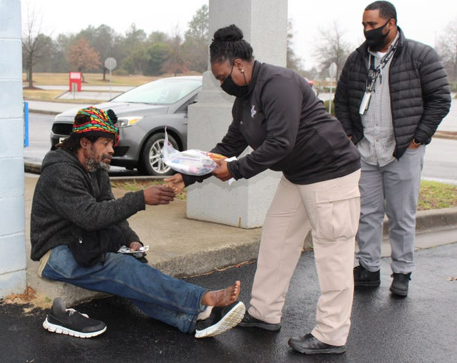 Members of the Richmond County Sheriff's Office Community Service Division handed out essential care packages including socks, jackets, masks, gloves and snacks to homeless people around Augusta in February.