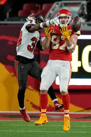 Tampa Bay Buccaneers free safety Jordan Whitehead breaks up a pass intended for Kansas City Chiefs tight end Travis Kelce during the second half of the NFL Super Bowl 55 football game Sunday, Feb. 7, 2021, in Tampa, Fla. (AP Photo/David J. Phillip)