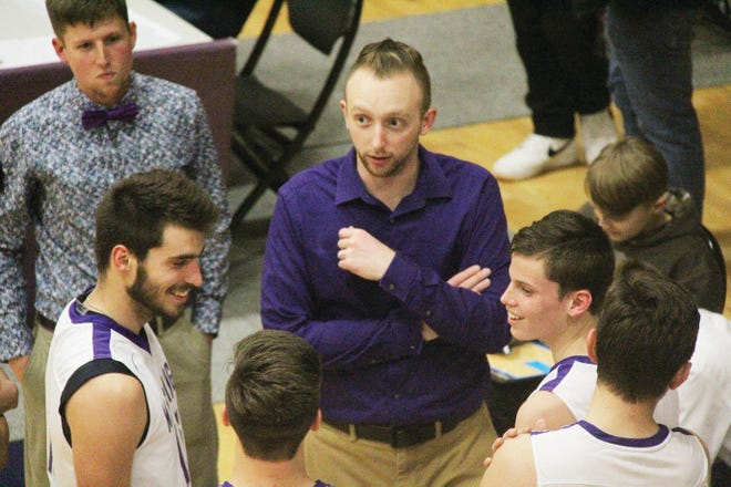 Wesleyan Christian School head boys basketball coach Kameron Nettleton, center, enjoys a light moment during a timeout in the 2019-20 season.