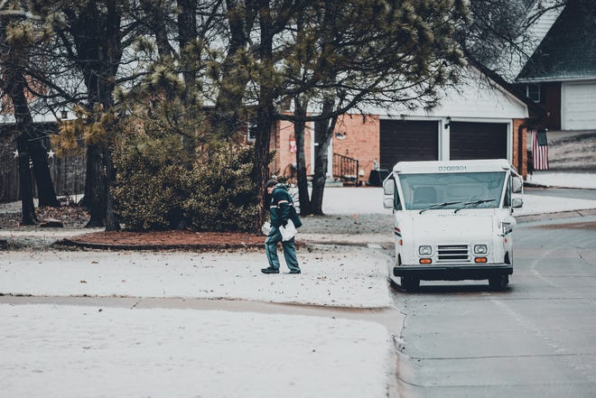 The wintry weather on Monday didn't keep this postal worker from making his rounds in Bartlesville.
