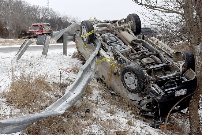 A Ford F150 pickup truck rests upside down after an accident at highway 63 and Lipscomb Road Monday. According to the Missouri Highway Patrol Fred Garmon, 80, of Cairo, was southbound on highway 63 and began sliding on ice while crossing a bridge. The pickup ran off the right side of the road, struck a guardrail and overturned. The man was treated by medics on the scene and released. Several accidents occurred Monday in Boone County because of slick roads.