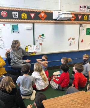 Heidi May, Field Elementary School nurse, talks to second graders about healthy dental habits and healthy eating.