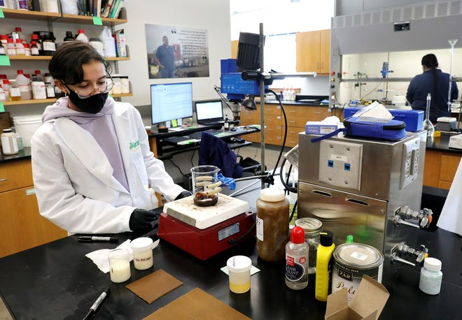 Intern Alejandra Coronel-Zegarra works on a soybean-based coating for tires at the Airable Research Lab at Ohio Wesleyan University on Monday. The lab is inventing ways to use soybeans in industry and everyday life.
